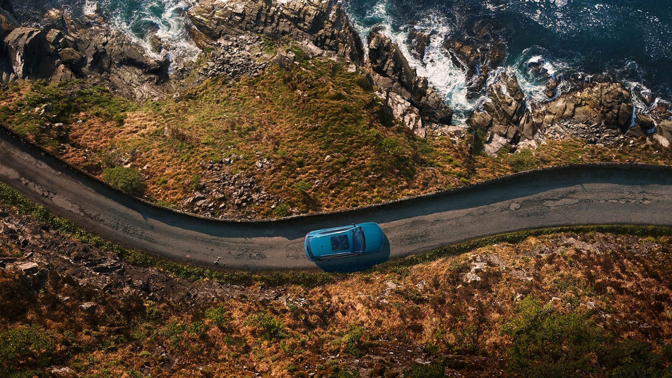 Birds eye view of the Audi e-tron driving along the coast